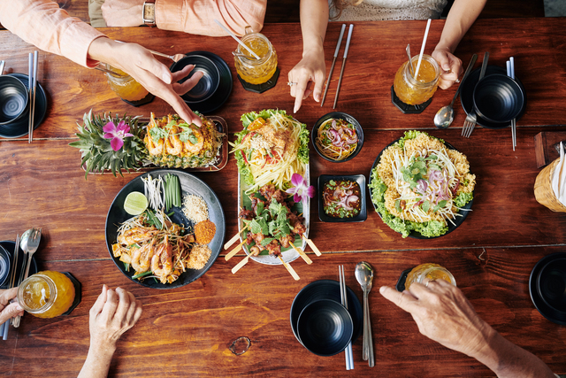 People enjoying Asian cuisine together